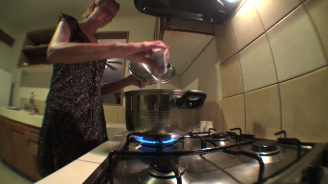housewife salting water on the pot to cook pasta - stereotypical housewife stock videos & royalty-free footage
