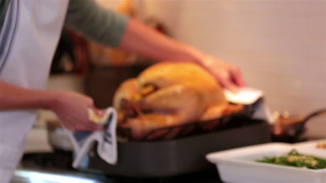 housewife takes turkey out of oven and smells - oven stock videos & royalty-free footage