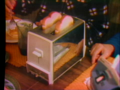 housewife uses various electrical appliances in her kitchen. - トースター点の映像素材/bロール