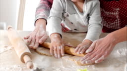 Housewife with her daughter preparing gingerbread
