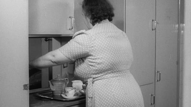 1951 montage housewives doing chores around the house while a husband is hammering in a workshop / united kingdom - 1950 stock videos and b-roll footage