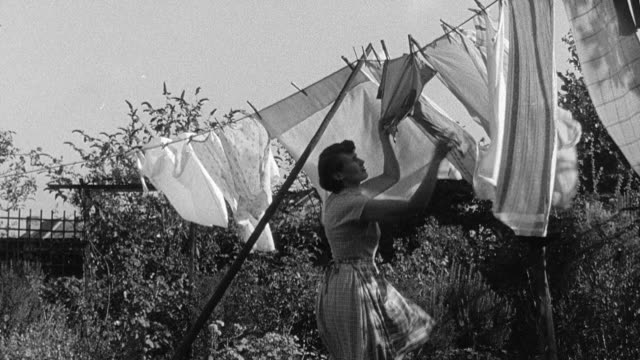 1956 montage housewives doing laundry/ london, united kingdom - 1950 stock-videos und b-roll-filmmaterial