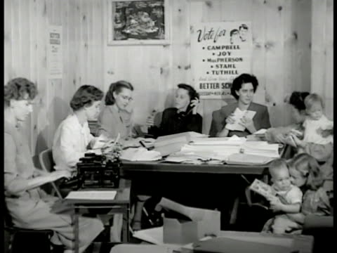 housewives working at table full of pamphlets, typing, telephone, writing, children playing fg. women at table working. list of names by telephone.... - 1947 stock videos & royalty-free footage