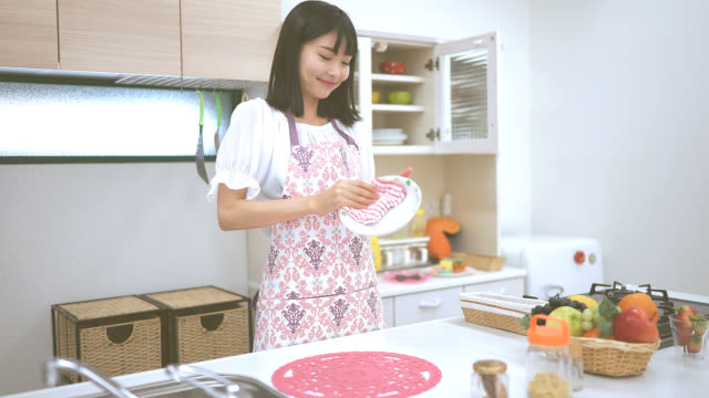 housework at kitchen of young wife - lavori di casa video stock e b–roll