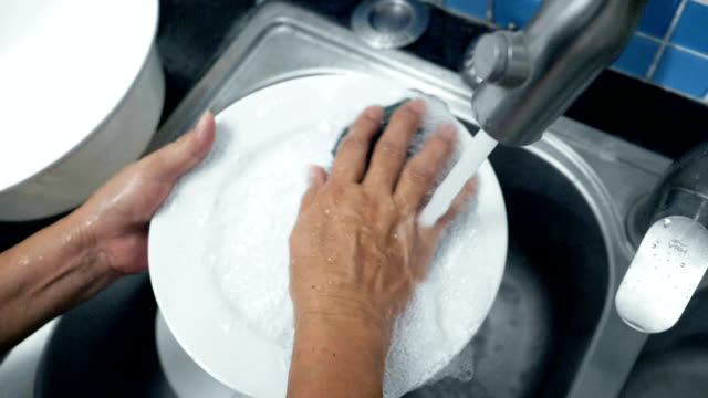 housework : grandmother washing dishes - sink stock videos and b-roll footage