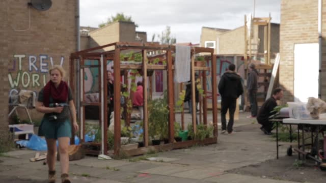 Baliffs move in to clear Sweets Way estate during time of increased homelessness 'Noah's Camp' banner on house next to others boarded up 'Noah's Ark...