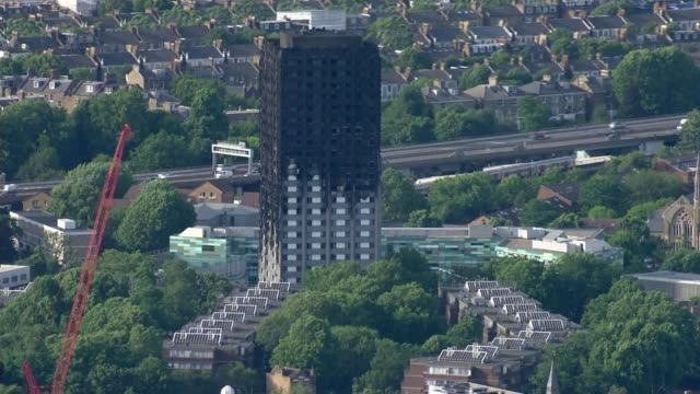 social housing in the wake of the grenfell tower tragedy air view blackened shell of grenfell tower - jackie long stock videos & royalty-free footage