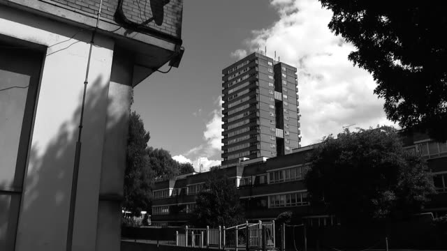 social housing in the wake of the grenfell tower tragedy graphicised sequence speeded up b/w footage tower block as turns to colour - jackie long stock videos & royalty-free footage