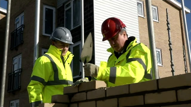 david cameron promises to double number of discounted homes for firsttime buyers england essex thurrock ext david cameron mp laying cement on brick... - thurrock stock videos and b-roll footage