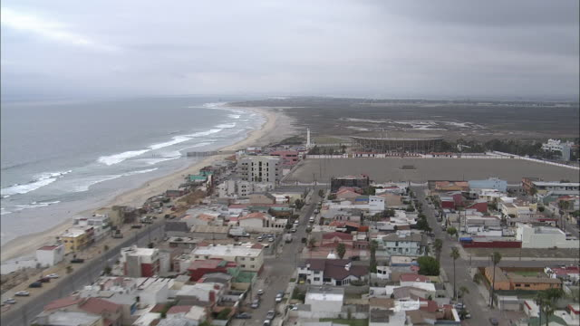 a housing development sprawls along a mexican coastline. - housing development stock videos & royalty-free footage