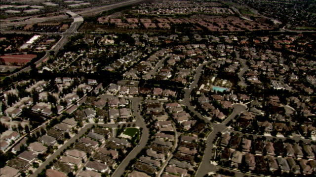 housing developments fill a suburb of los angeles. available in hd. - southern california stock videos and b-roll footage