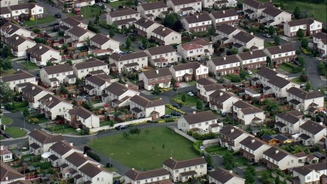 housing estates  - aerial view - helicopter filming,  aerial video,  cineflex,  establishing shot,  ireland - housing difficulties stock videos & royalty-free footage