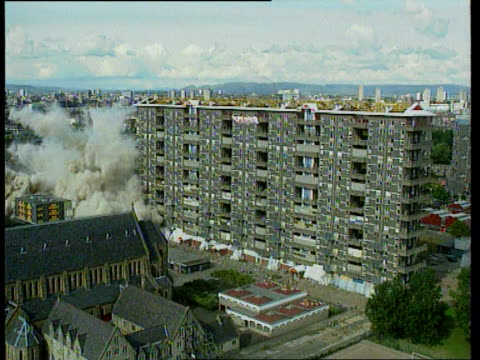 stockvideo's en b-roll-footage met government promises action itn lib scotland glasgow flats being demolished with explosives england newcastle boarded up houses on council estate track - newcastle upon tyne