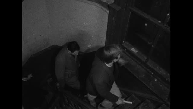 housing officers check the heating system of a dilapidated tenement building in the bronx - social service bildbanksvideor och videomaterial från bakom kulisserna