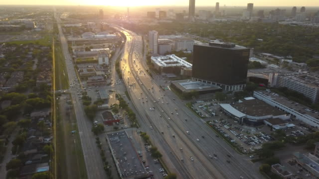 vidéos et rushes de houston highway at sunset, aerial - texas