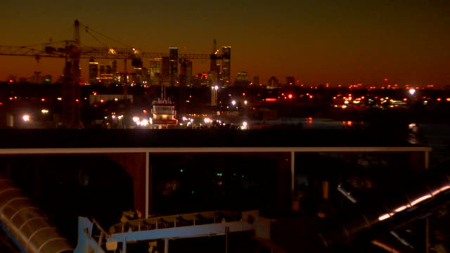 Houston skyline at night from industrial plant