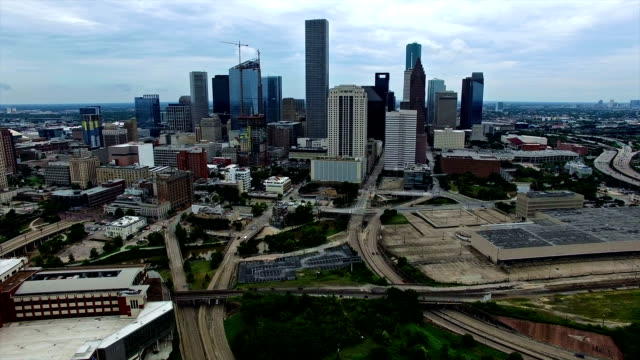 Houston Texas Aerial Fly By Skyline Cityscape with Traffic on Interstate I10