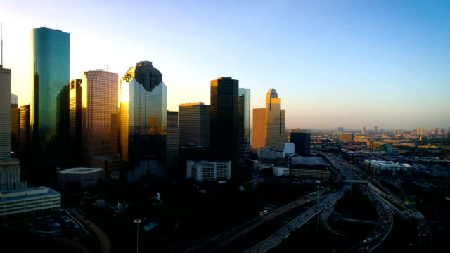 houston texas perfect golden sun flares off glass of downtown skyscrapers - texas stock videos & royalty-free footage