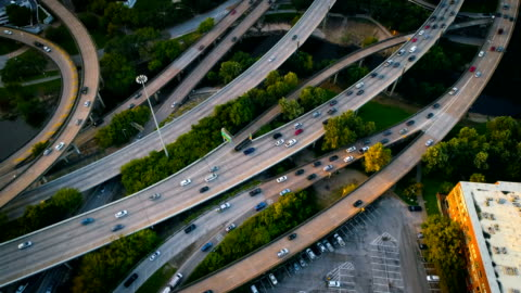 slow motion: houston traffic highways and interstates - highway stock videos & royalty-free footage
