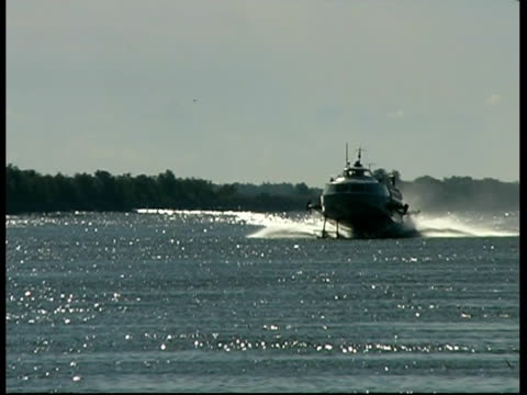 hovercraft approaching along river danube, romania - hovercraft stock videos & royalty-free footage