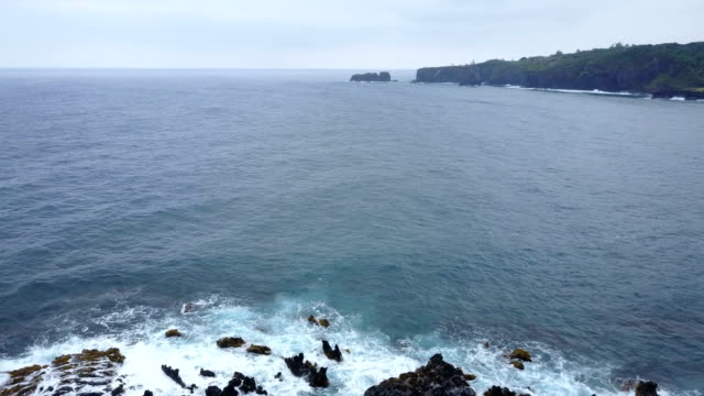 Hovering Above Rocky Shoreline on Maui Island