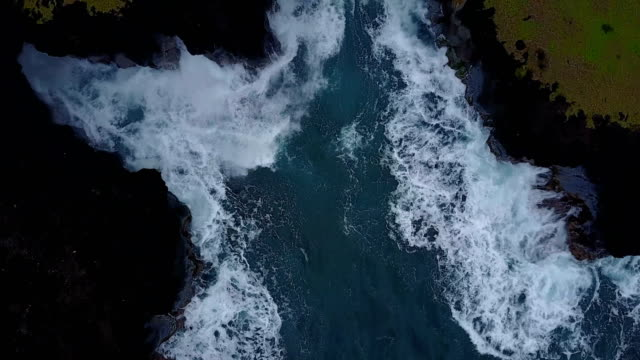 Hovering Above Rough Water Crashing Into Rocky Outcrop