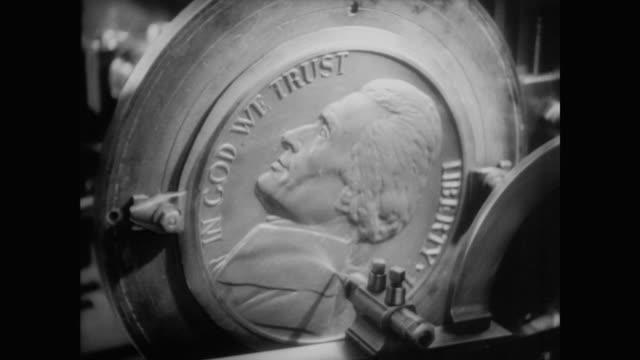 1940 how the jefferson nickel is made - moneta da 5 centesimi statunitensi video stock e b–roll