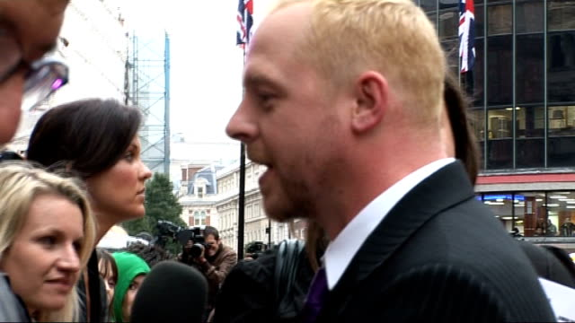 'How to Lose Friends and Alienate People' London premiere Simon Pegg talking to press on red carpet/ fans behind barriers/ unidentified cast members...