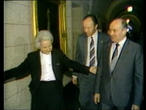 stockvideo's en b-roll-footage met how well do the british public know the current world leaders tx russian ldrmikhail gorbachov others towards and through door rl cms gorbachov seated - 1985