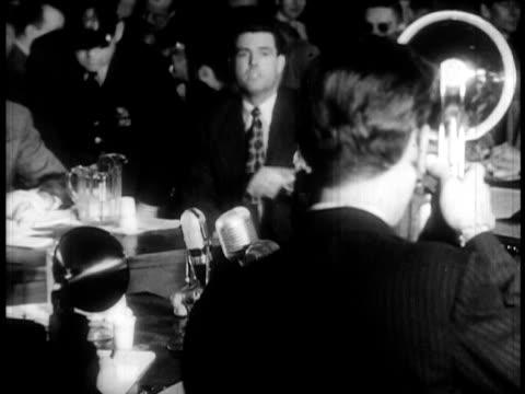howard biberman of hollywood ten speaking angrily at huac trial as reporters take photos - communism stock videos & royalty-free footage
