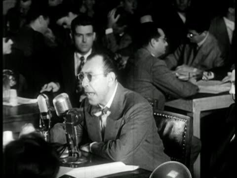 vidéos et rushes de howard biberman of hollywood ten testifying at huac hearings / newsreel - law