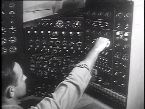 howard hughes checking engineer's instrument panel / engineer adjusting knob / hughes climbs into pilot's seat - 1947 stock videos & royalty-free footage