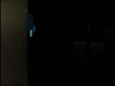 howard hughes in london:; a: england: london: inn on the park hotel: int av closed circuit tv including tilt to double doors leading to suite av tv... - entrance hall stock videos & royalty-free footage