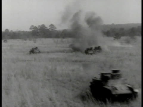 howitzer cannons firing. light armored tanks on field shells exploding. fighter airplanes bombing tanks on road. soldiers on tank firing machine gun... - allied forces stock videos & royalty-free footage