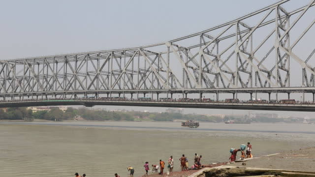 howrah bridge in kolkata - howrah bridge stock videos & royalty-free footage