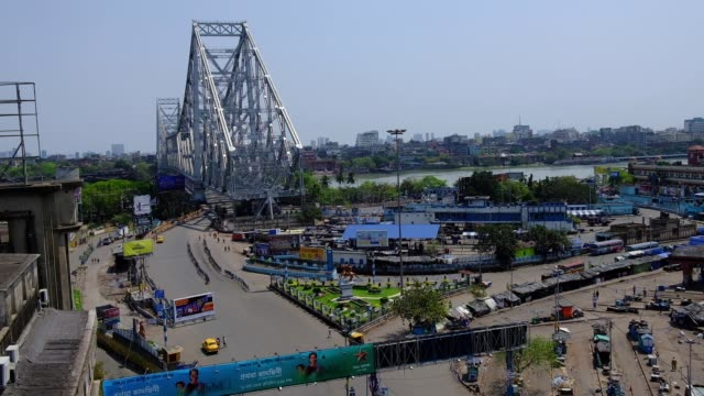howrah bridge is the most busiest place of kolkata and howrah is totally empty due to coronavirus pandemic. indian prime minister narendra modi... - howrah bridge stock videos & royalty-free footage