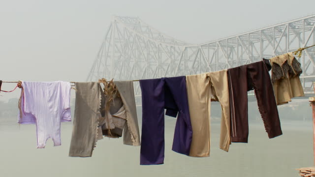 ms howrah bridge with clothes line / calcutta, west, bengal india - howrah bridge stock videos & royalty-free footage