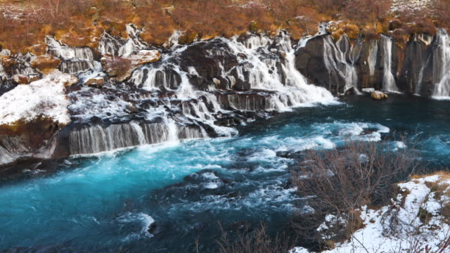 hraunfossar falls in winter - origins stock videos & royalty-free footage