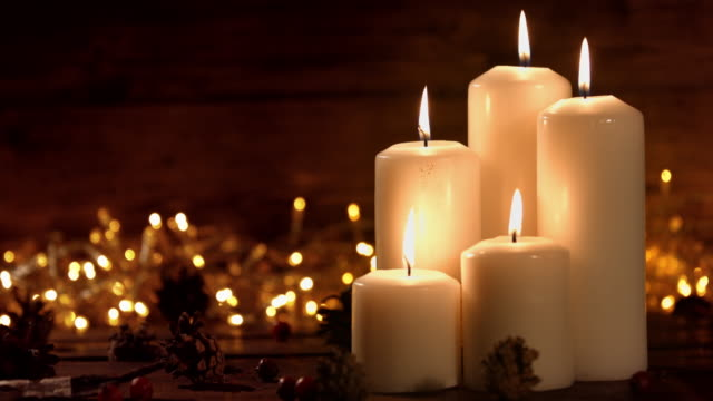 hristmas composition with burning white candles and stars ornaments - candle stock videos & royalty-free footage