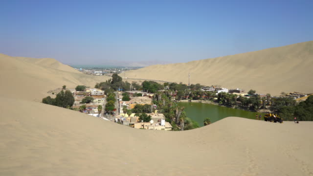 huacachina oasis in ica peru - desert oasis stock videos & royalty-free footage