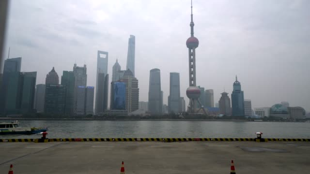 huangpu river is the main river flowing through the downtown shanghai. one side is the travel landmark of the bund, and the other side is the... - river huangpu stock videos & royalty-free footage