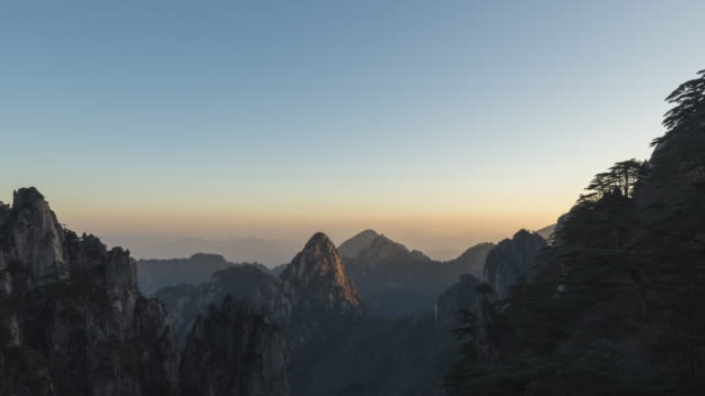 Huangshan mountain at dawn - night to day - time lapse