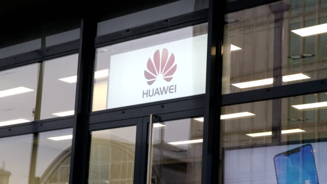 huawei customer service center in berlin with advertising sign and logo of huawei on march 15, 2019 in berlin, germany. the u.s. government has... - big brother orwellian concept stock videos & royalty-free footage