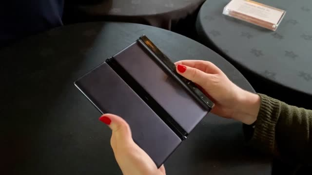 huawei has unveiled a new version of its foldable smartphone, which is set to be released outside mainland china for the first time. the mate xs is... - releasing stock videos & royalty-free footage