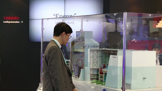 a huawei technologies co employee speaks to an attendee at the company's booth at the the 22nd world energy congress in daegu south korea on... - daegu stock videos and b-roll footage