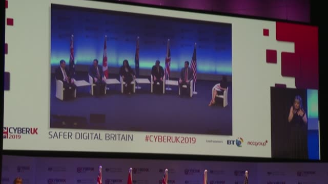 huawei to take part in creating uk's 5g mobile phone network; scotland: glasgow: various shots people at cyber uk security conference ciaran martin... - conference phone stock videos & royalty-free footage
