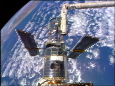Hubble Space Telescope moving over Earth / STS-82