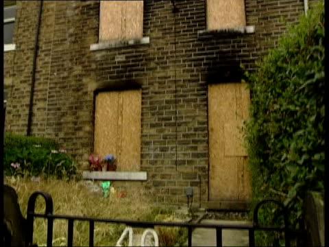 arson attack man convicted of 8 murders itn england yorkshire huddersfield boarded up house where eight members of a family died after an arson... - window sill stock videos and b-roll footage