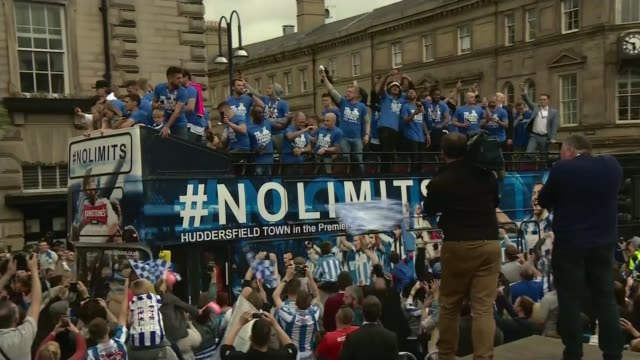 Huddersfield Town celebrates promotion to Premier League ENGLAND West Yorkshire Huddersfield EXT Various shots Huddersfield fans celebrating...