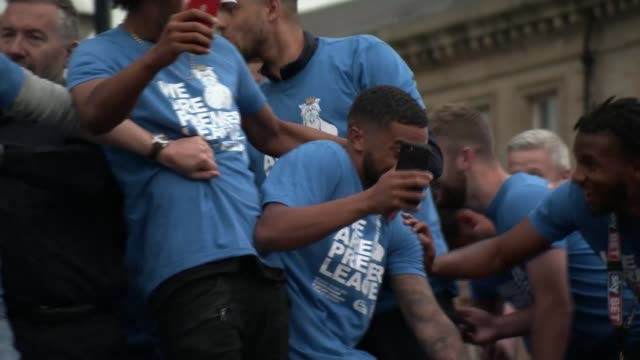 Huddersfield Town celebrates promotion to Premier League Various shots Huddersfield fans in victory parade Opentop bus with Huddersfield team along...